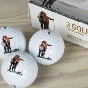 """Golfbolde af mærket Titleist   Æske 2   Motiv: Inspireret af Michael Anchers billede """"Vil han klare pynten?"""""""